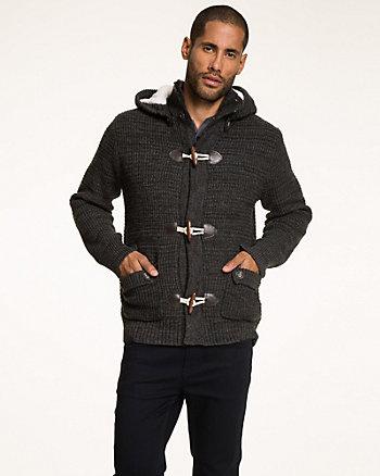 Manteau de tricot et fourrure synthétique