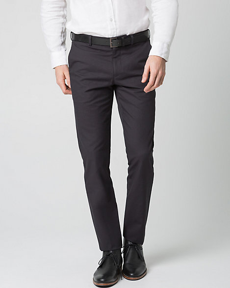 "Le Chateau - A stylish two-tone pant is cut from a breathable cotton blend, and finished in a flattering slim leg. Cotton blend. Low waisted, button closure. Belt included, suspender buttons. J-pockets, welt pockets. Slim leg. Rise: 8"". 70% Cotton 30% Polyester. Imported."
