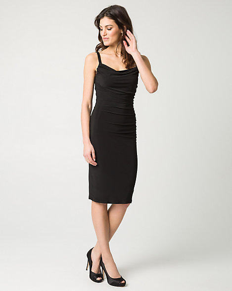 "Le Chateau - A cowl neckline and fitted silhouette make this dress design a sleek and chic addition to your dress repertoire. Knit. Tank, sleeveless. Fitted, straight hem. 41"" from high shoulder point. 95% Polyester 5% Spandex. Made in Canada. Please note that this dress will be delivered with an additional return tag attached. The dress cannot be returned once return tag is removed."