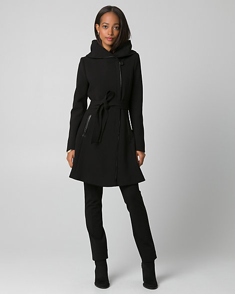 "Le Chateau - An asymmetrical zip-front and leather-like trim bring chic style to a hooded double weave coat, while its cinched-waist and flared silhouette offer feminine flattery. Double weave. Asymmetrical zip-front, long sleeves. Hooded, belted. Fit & flare, straight hem. 35.5"" from centre back. 63% Polyester 33% Rayon 4% Spandex. Made in Canada."