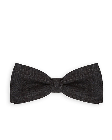 Le Chateau - Tonal checks touch up a handsome wool bow tie made in Italy. 100% Wool. Made in Italy.
