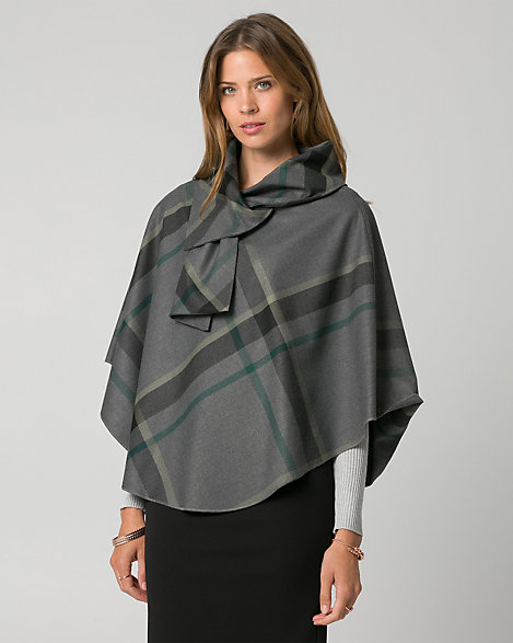 "Le Chateau - A dramatic cowl neck defines a chic poncho in a thick double weave with a cool, borrowed-from-the-boys check print. Double weave viscose blend. Cowl neck, sleeveless. Poncho, rounded hem. 26"" from centre back. 65% Polyester 32% Viscose 3% Spandex. Made in Canada."