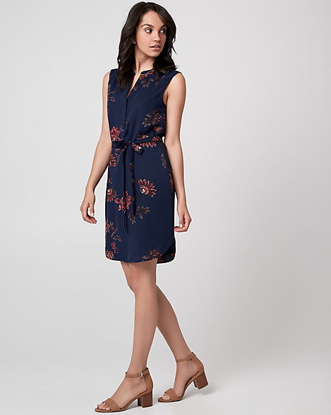 "Le Chateau - Soak up the sun in an easy, floral print dress that's perfect for wherever the day takes you. Designed with soft shoulder pleats and a flattering waist tie. Cr pe de Chine. V-neck, sleeveless. Waist tie. Loose, rounded hem. 38"" from high shoulder point. 100% Polyester. Imported."