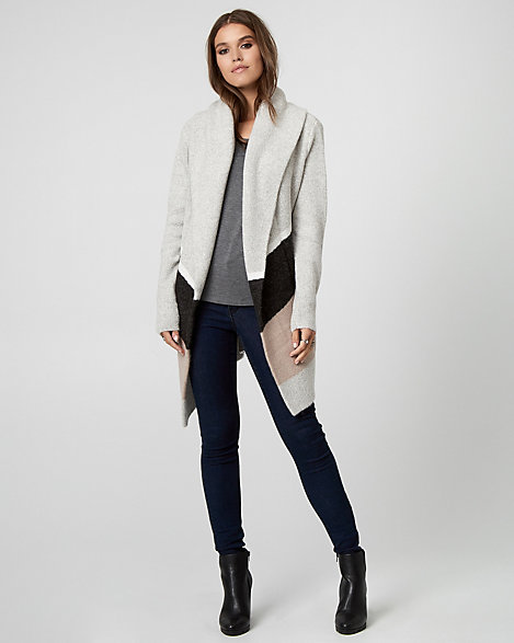 "Le Chateau - This colour block, knit sweater coat is the coziest and easiest transitional piece for off-duty style. Knit. Open-front, long sleeves. Straight hem. 30"" from centre back. 59% Acrylic 18% Cotton 17% Nylon 5% Polyester 1% Spandex. Imported."