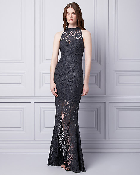 "Le Chateau - Corded lace flows from the high neck to the sheer, slit hem of this classically lace gown. Corded lace. Mock neck, sleeveless. Front slit. Fitted, straight hem. 65"" from high shoulder point. 59% Nylon 41% Rayon. Made in Canada. Please note that this dress will be delivered with an additional return tag attached. The dress cannot be returned once return tag is removed."