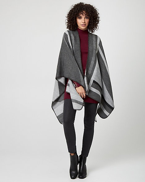 Le Chateau - Colour block styling lends a bold, contemporary look to a woven poncho. Woven. Open-front, sleeveless. Poncho, uneven hem. 95% Acrylic 5% Polyester. Imported.
